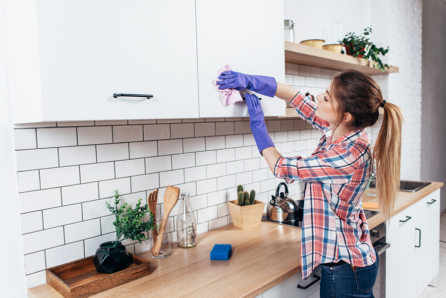 Woman cleaning kitchen in springtime